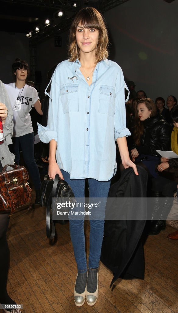 Alexa Chung poses on the front row at the House Of Holland show for London Fashion Week Autumn/Winter 2010 at Bloomsbury Ballroom on February 20, 2010 in London, England.
