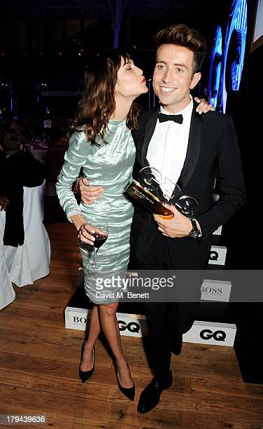 Alexa Chung presents Nick Grimshaw with the award for Best Radio Personality at the GQ Men of the Year awards at The Royal Opera House on September 3...