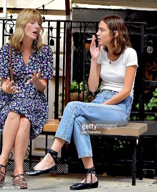 Alexa Chung shares a cigarette with a friend in Soho on September 13 2016 in New York City