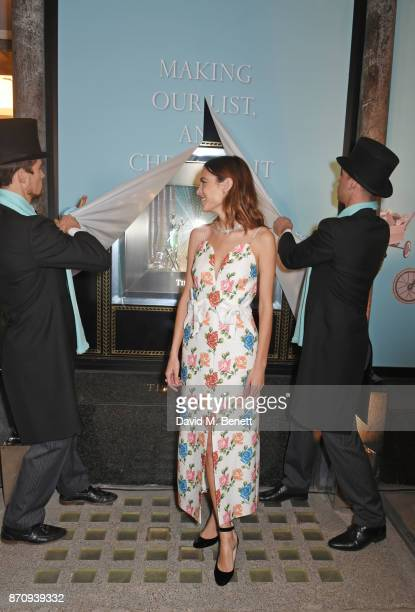 Alexa Chung sparkles outside the Tiffany Co Old Bond Street Store as she unveils the Tiffany Christmas windows at Tiffany Co on November 6 2017 in...