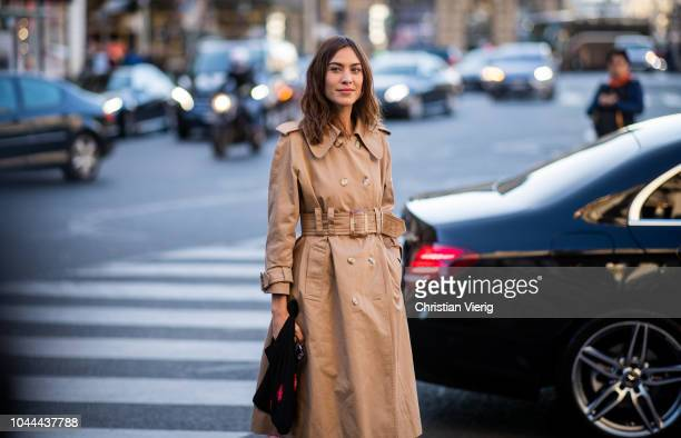Alexa Chung wearing belted trench coat maxi dress seen outside Stella McCartney during Paris Fashion Week Womenswear Spring/Summer 2019 on October 1...