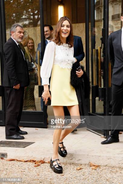 Alexa Chung wearing Miu Miu outside Miu Miu during Paris Fashion Week Womenswear Spring Summer 2020 on October 01 2019 in Paris France