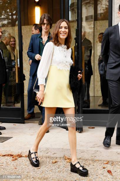 Alexa Chung wearing Miu Miu outside Miu Miu during Paris Fashion Week Womenswear Spring Summer 2020 on October 01 2019 in Paris France