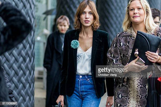 Alexa Chung wearng a dark green velvet blazer a white blouse and a blue denim jeans seen outside Emilia Wickstaed during London Fashion Week...