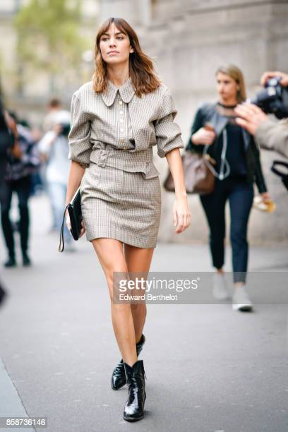 Alexa Chung wears a checkered dress outside Stella Mccartney during Paris Fashion Week Womenswear Spring/Summer 2018 on October 2 2017 in Paris France