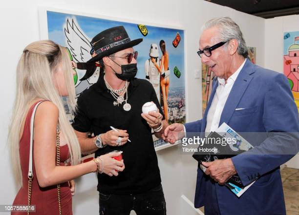 Alexa Dellanos Alec Monopoly and Edward Mady attend the Alec Monopoly Beverly Hills Hotel Capsule Collection unveiling on November 4 2018 in Beverly...