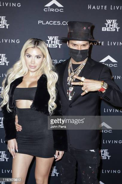 Alexa Dellanos and Alec Monopoly arrive at the We The Best Foundation And Haute Living Present The Nicole And Khaled Birthday Celebration With...