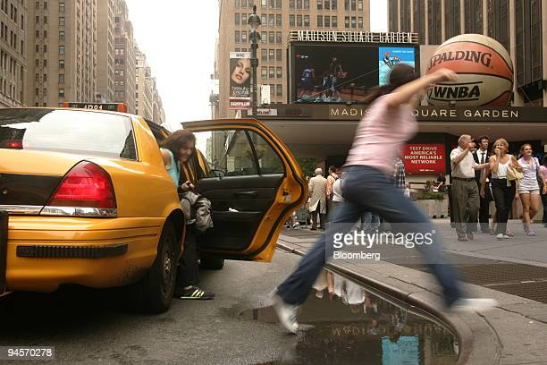 Alexa Fumerton jumps over a puddle outside Penn Station in New York Wednesday July 18 2007 Thunderstorms pounded the region with heavy rains this...