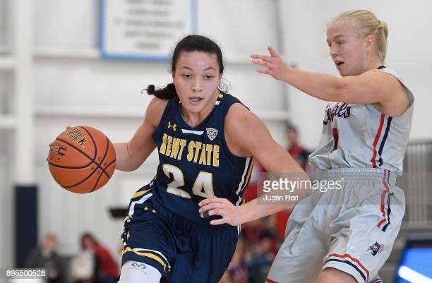 Alexa Golden of the Kent State Golden Flashes dribbles against Nina Augustin of the Robert Morris Colonials in the second half during the game at...