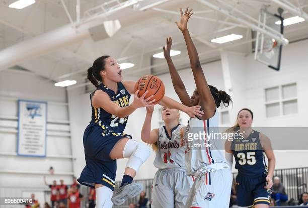 Alexa Golden of the Kent State Golden Flashes goes to the basket against Mikalah Mulrain of the Robert Morris Colonials in the second half during the...