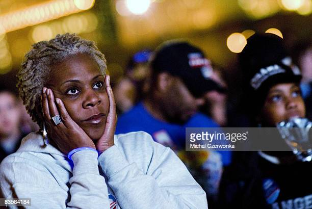 Alexa Gonazles of Chicago reacts to early exit polls in the nonticket holder area of Grant Park where later tonight Democratic US presidential...