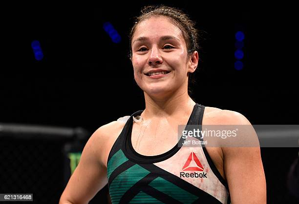 Alexa Grasso of Mexico celebrates her victory over Heather Jo Clark of the United States in their women's strawweight bout during the UFC Fight Night...