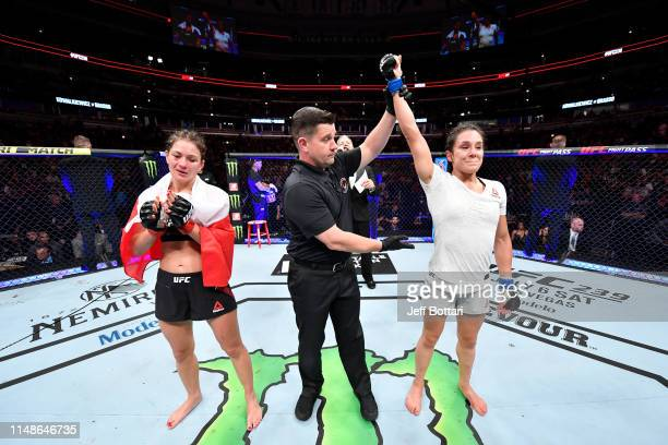 Alexa Grasso of Mexico celebrates her victory over Karolina Kowalkiewicz of Poland in their women's strawweight bout during the UFC 238 event at the...