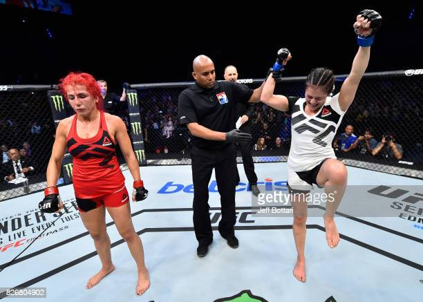 Alexa Grasso of Mexico celebrates her victory over Randa Markos of Iraq raise their hands after their women's strawweight bout during the UFC Fight...