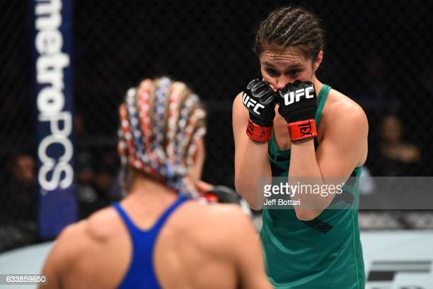 Alexa Grasso of Mexico circles Felice Herrig in their women's strawweight bout during the UFC Fight Night event at the Toyota Center on February 4...