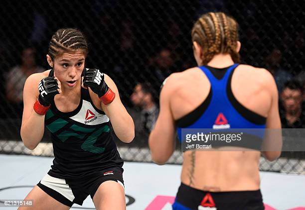 Alexa Grasso of Mexico circles Heather Jo Clark of the United States in their women's strawweight bout during the UFC Fight Night event at Arena...
