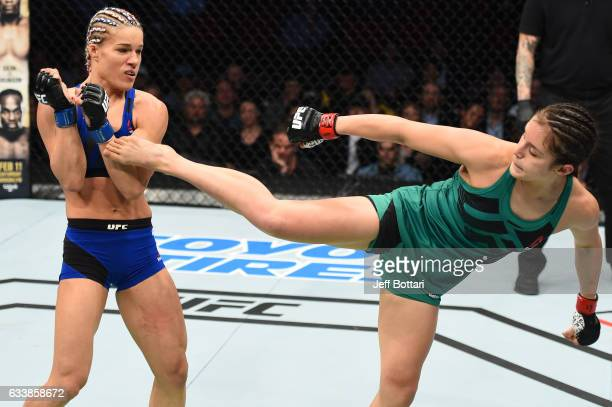 Alexa Grasso of Mexico kicks Felice Herrig in their women's strawweight bout during the UFC Fight Night event at the Toyota Center on February 4 2017...