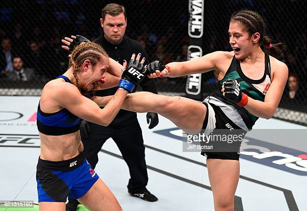 Alexa Grasso of Mexico kicks Heather Jo Clark of the United States in their women's strawweight bout during the UFC Fight Night event at Arena Ciudad...