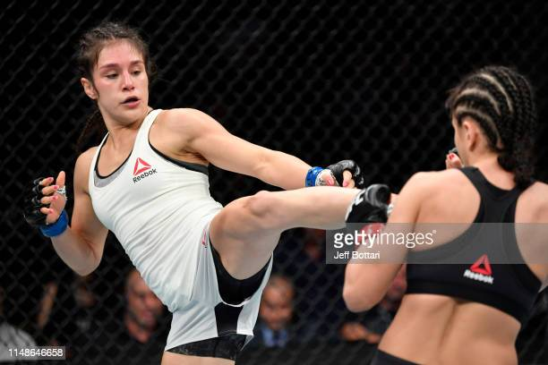 Alexa Grasso of Mexico kicks Karolina Kowalkiewicz of Poland in their women's strawweight bout during the UFC 238 event at the United Center on June...