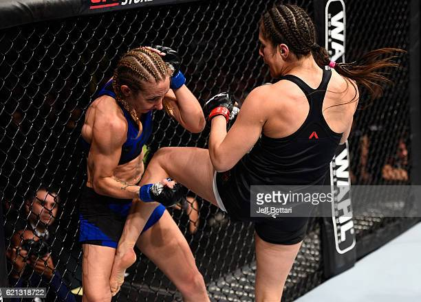 Alexa Grasso of Mexico knees Heather Jo Clark of the United States in their women's strawweight bout during the UFC Fight Night event at Arena Ciudad...