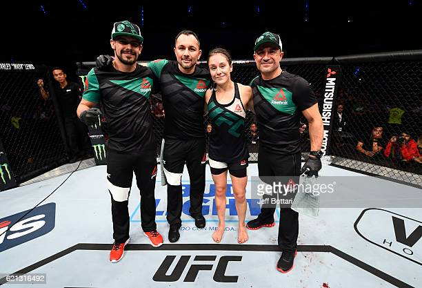 Alexa Grasso of Mexico poses for a picture with her team after facing Heather Jo Clark of the United States in their women's strawweight bout during...