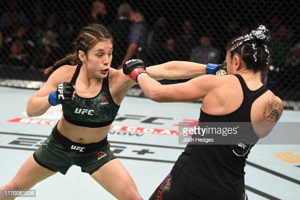 Alexa Grasso of Mexico punches Carla Esparza in their women's strawweight bout during the UFC Fight Night event on September 21 2019 in Mexico City...