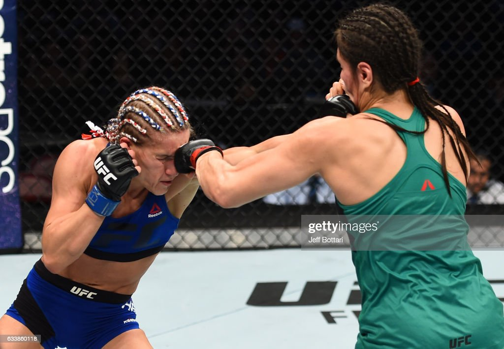 Alexa Grasso of Mexico punches Felice Herrig in their women's strawweight bout during the UFC Fight Night event at the Toyota Center on February 4, 2017 in Houston, Texas.