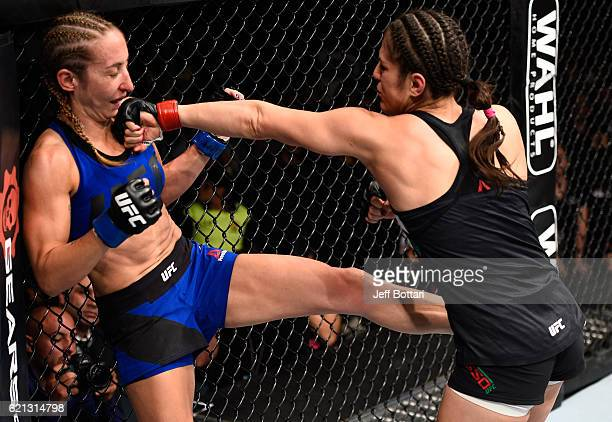 Alexa Grasso of Mexico punches Heather Jo Clark of the United States in their women's strawweight bout during the UFC Fight Night event at Arena...