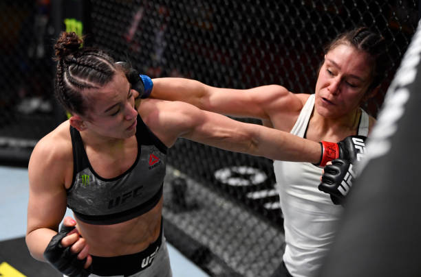 Alexa Grasso of Mexico punches Maycee Barber in their flyweight fight during the UFC 258 event at UFC APEX on February 13, 2021 in Las Vegas, Nevada.