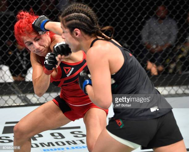 Alexa Grasso of Mexico punches Randa Markos of Iraq in their women's strawweight bout during the UFC Fight Night event at Arena Ciudad de Mexico on...
