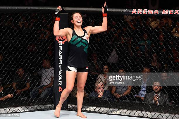 Alexa Grasso of Mexico raises her hands after facing Heather Jo Clark of the United States in their women's strawweight bout during the UFC Fight...