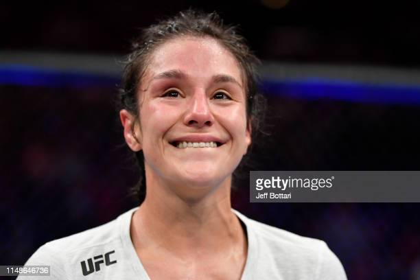Alexa Grasso of Mexico reacts after the conclusion of her women's strawweight bout against Karolina Kowalkiewicz of Poland during the UFC 238 event...