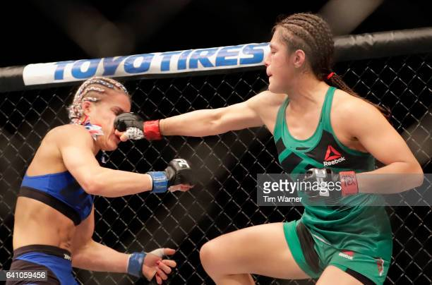 Alexa Grasso punches Felice Herrig in the Women's Strawweight Bout during UFC Fight Night at the Toyota Center on February 4 2017 in Houston Texas
