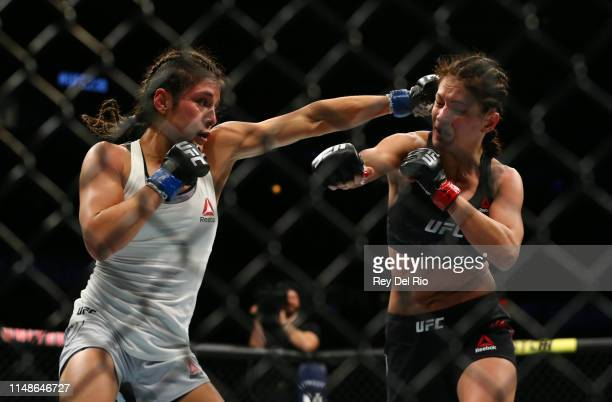 Alexa Grasso punches Karolina Kowalkiewicz at United Center on June 8 2019 in Chicago Illinois