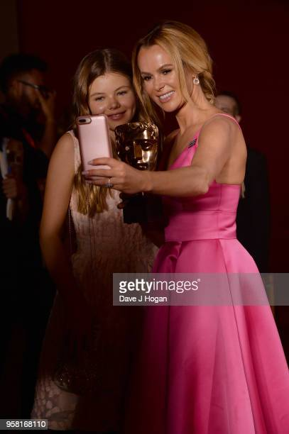 Alexa Hughes and Amanda Holden pose in the press room at the Virgin TV British Academy Television Awards at The Royal Festival Hall on May 13 2018 in...