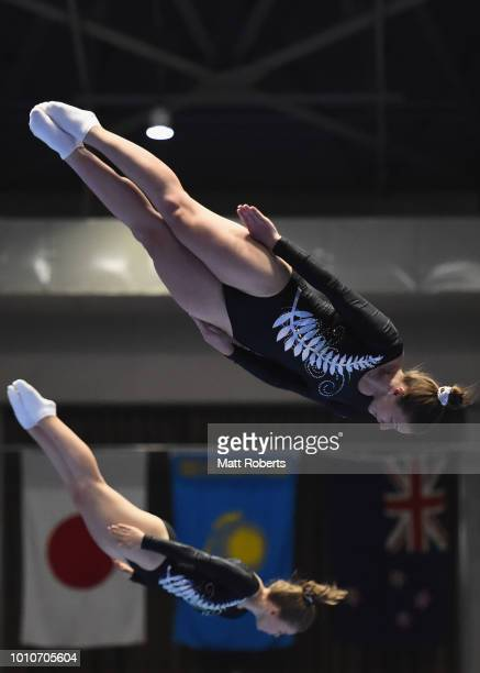 Alexa Kennedy and Madaline Davidson of New Zealand compete during the Women's Synchro on day one of the Trampoline World Cup at Yamato Citizens...