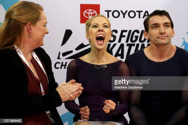 Alexa Knierim and Christopher Knierim celebrate with coach Jenni Meno their scores in the Pairs Free skate during the 2020 US Figure Skating...