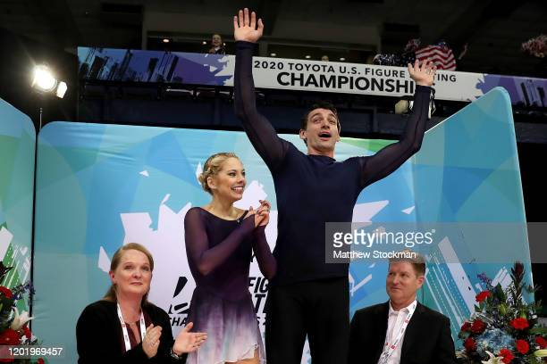 Alexa Knierim and Christopher Knierim celebrate with coaches Jenni Meno and Todd Sand their scores in the Pairs Free skate during the 2020 US Figure...
