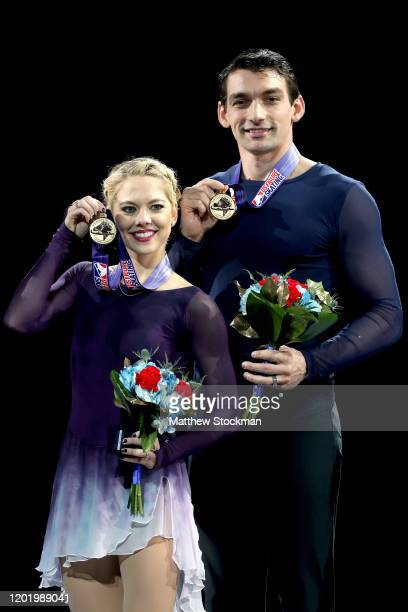 Alexa Knierim and Christopher Knierim pose on the medals podium after the Pairs Competition during the 2020 U.S. Figure Skating Championships at...