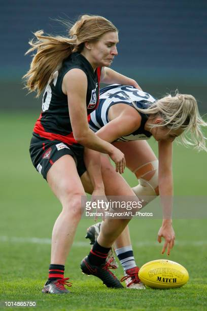 Alexa Madden of Essendon tackles Amy McDonald of Geelong during the round 14 VFLW match between the Essendon Bombers and the Geelong Cats at GMHBA...