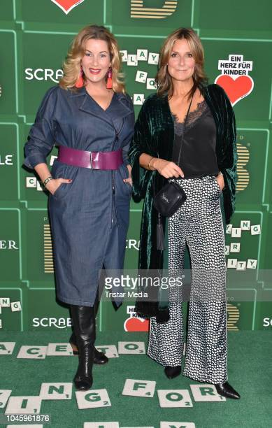 Alexa Maria Surholt and Kim Fisher attend the charity event PLACE TO B Playing for Charity at Restaurant GRACE on October 4 2018 in Berlin Germany