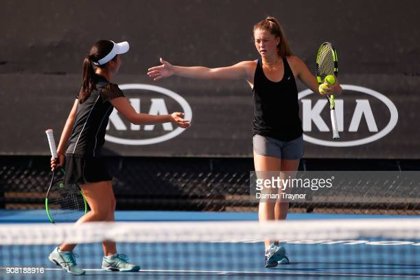 Alexa Noel of the United States and Rina Saigo of Japan in their doubles match against Elysia Bolton of the United States and Nicole Mossmer of the...