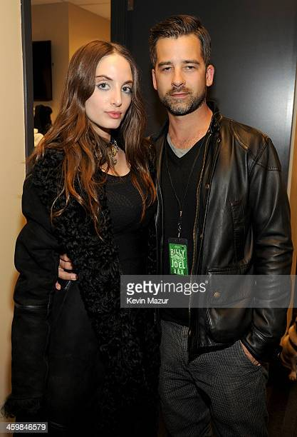 Alexa Ray Joel and Ryan Gleason pose backstage at the Billy Joel New Year's Eve Concert at the Barclays Center of Brooklyn on December 31 2013 in New...