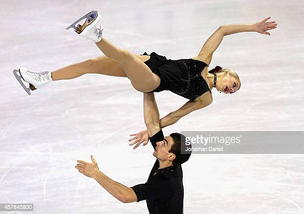 Alexa Scimeca and Chris Knierim compete in the Pairs Short Program during the 2014 Hilton HHonors Skate America competition at the Sears Centre Arena...