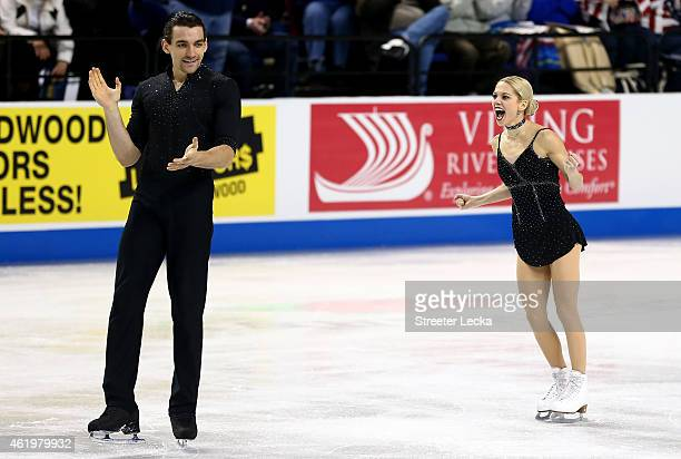 Alexa Scimeca celebrates with her partner Christopher Knierim after their competing in the Championship Pairs Short Program Competition during day 1...