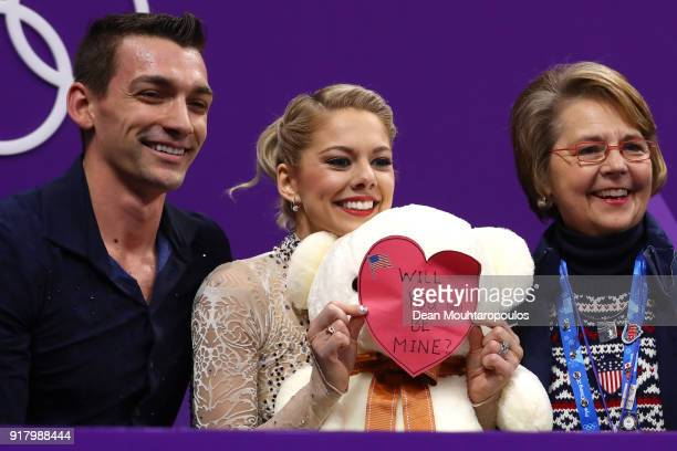 Alexa Scimeca Knierim holds up a valentine alongside Chris Knierim of the United States after their routine during the Pair Skating Short Program on...