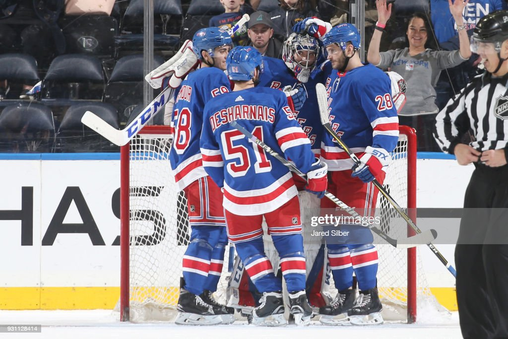 Alexandar Georgiev #40 and members of the New York Rangers celebrate after getting the 6-3 win against the Carolina Hurricanes at Madison Square Garden on March 12, 2018 in New York City.
