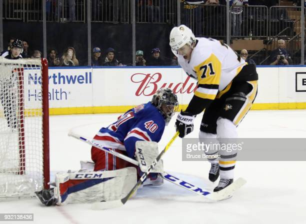Alexandar Georgiev of the New York Rangers makes the save on Evgeni Malkin of the Pittsburgh Penguins on the penalty shot with ten seconds remaining...