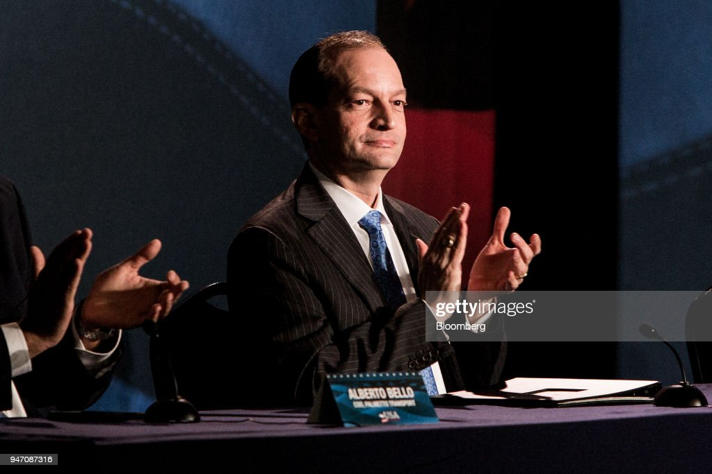 Alexander Acosta, U.S. labor secretary, applauds as U.S. President Donald Trump, not pictured, speaks during a roundtable discussion on tax cuts for Florida small businesses in Hialeah, FL on Monday, April 16, 2018. Trump accused China and Russia of devaluing their currencies, breaking from his own Treasury chief's view that no major trading partners are currency manipulators. Photographer: Scott McIntyre/Bloomberg via Getty Images