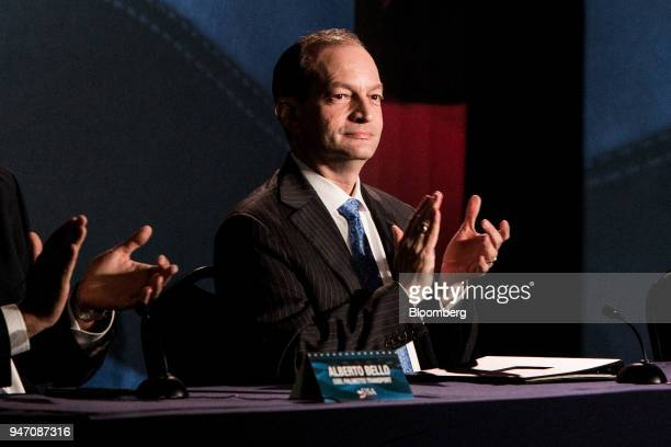 Alexander Acosta US labor secretary applauds as US President Donald Trump not pictured speaks during a roundtable discussion on tax cuts for Florida...